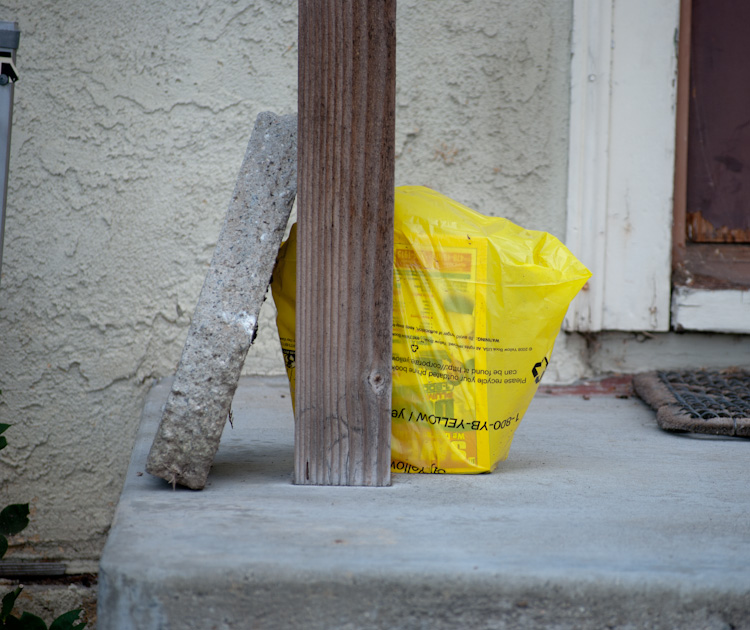 phone book in bag behind pole and block