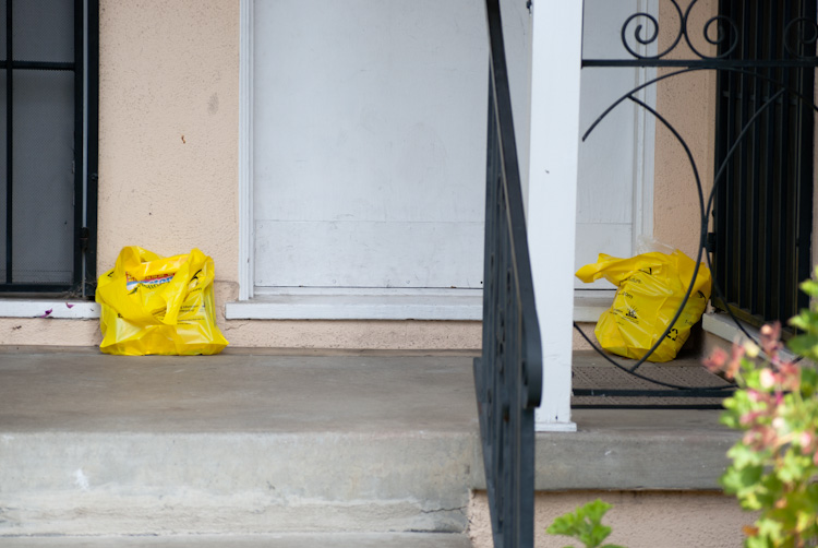 phone books in bags on porch with rails