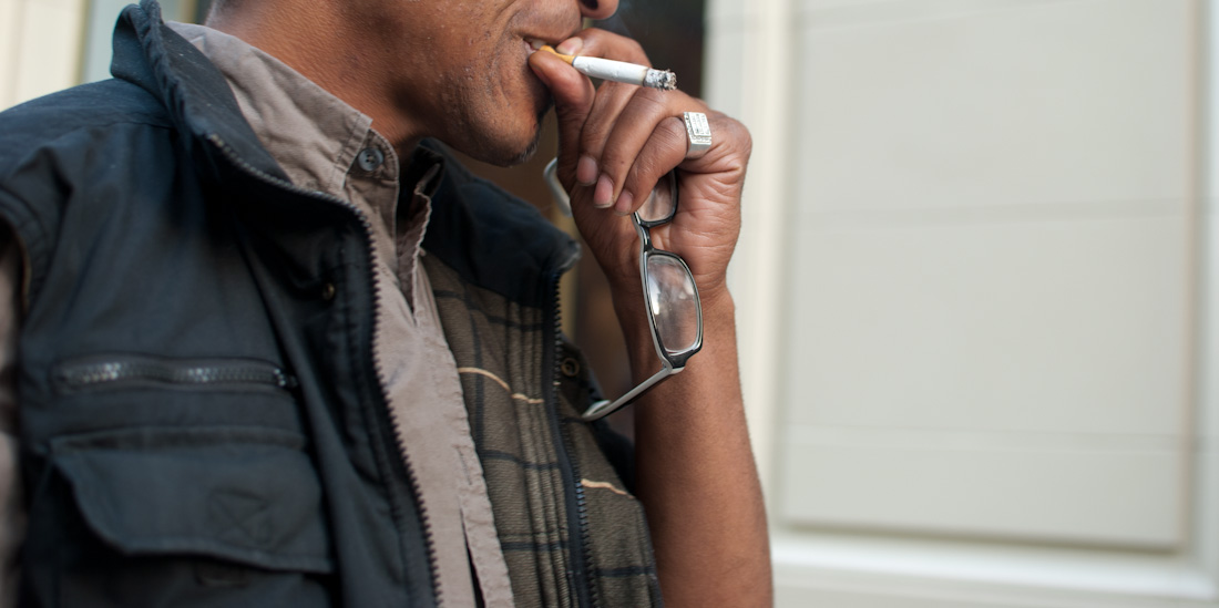 hand with glasses and cigarette