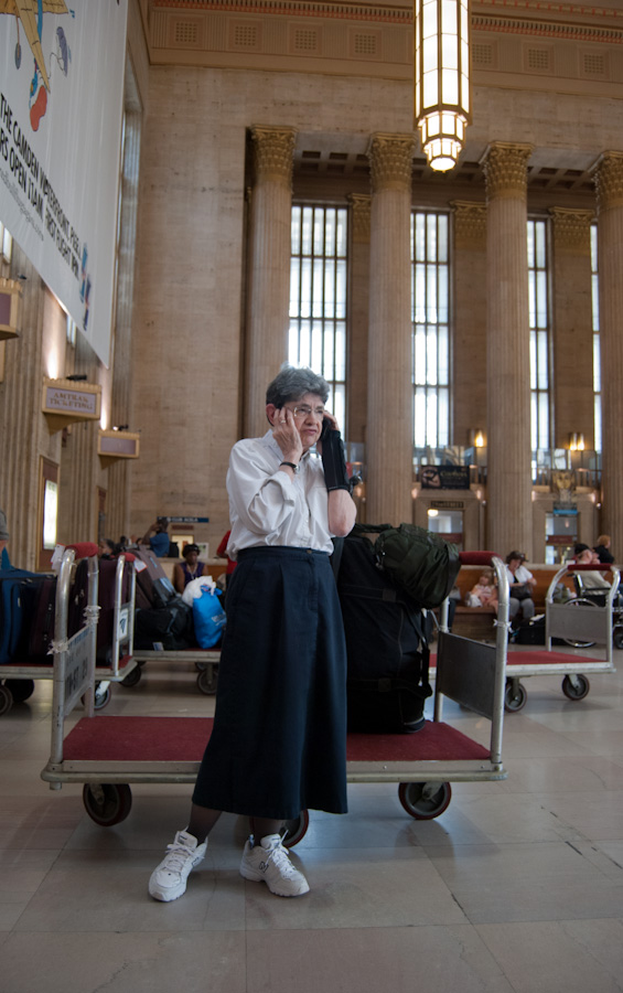 woman using phone in train station