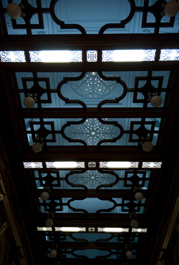 hallway ceiling with open woodwork and painted stars