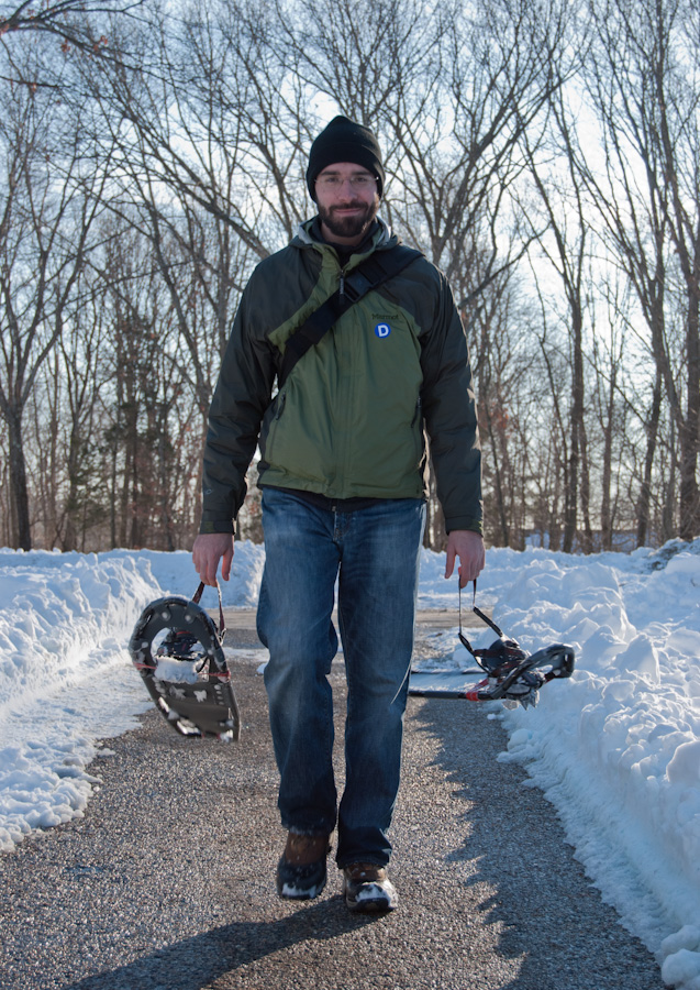 Matthew carrying snowshoes
