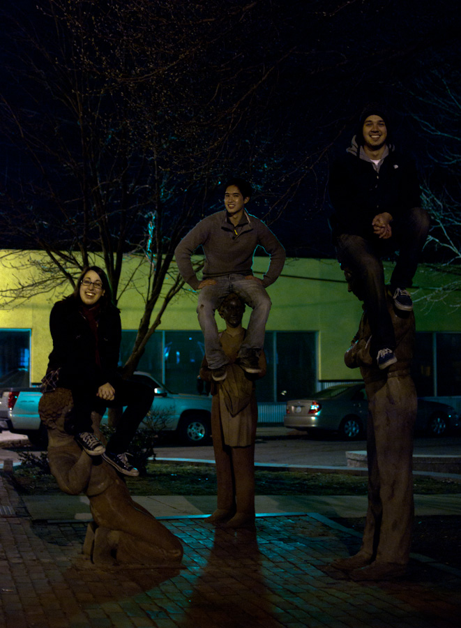 group sitting on statues