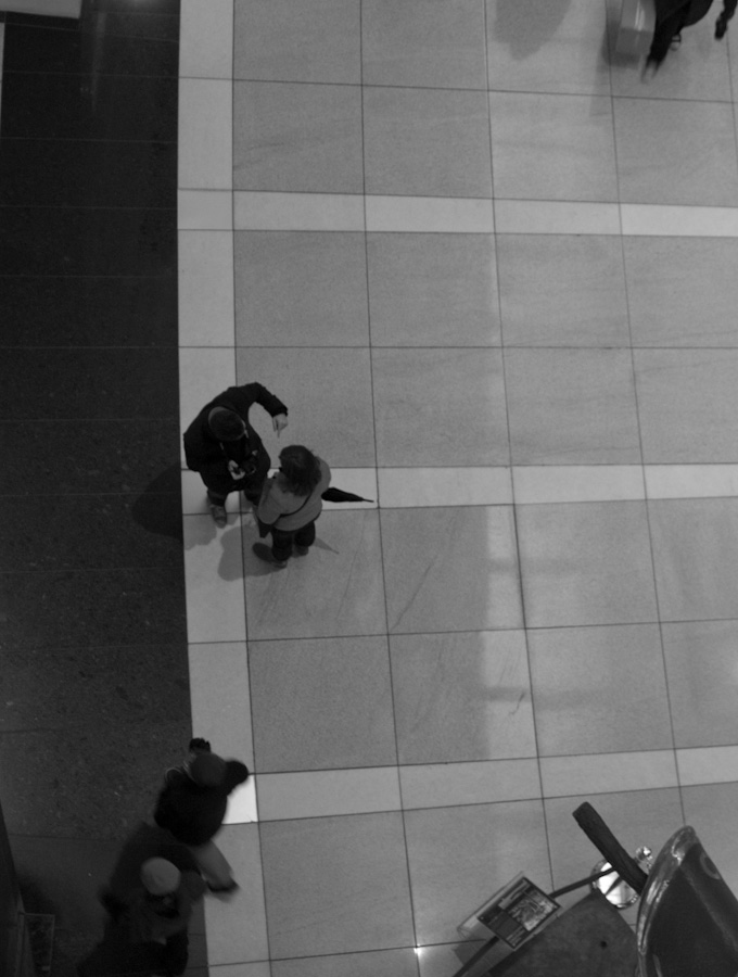 couple in mall, man pointing
