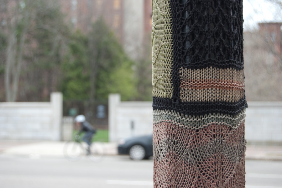 knitting on pole with street