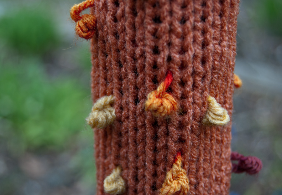orange sleeve on fence, loops detail