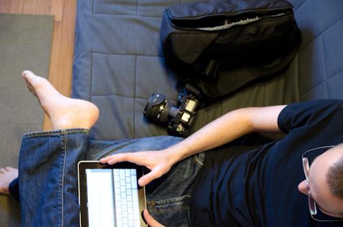 Matthew on futon with iPad