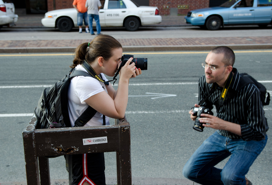 photographers facing each other