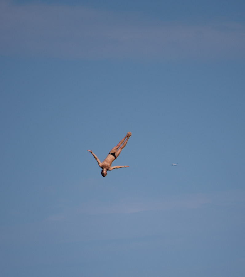 cliff diver downard with airplane