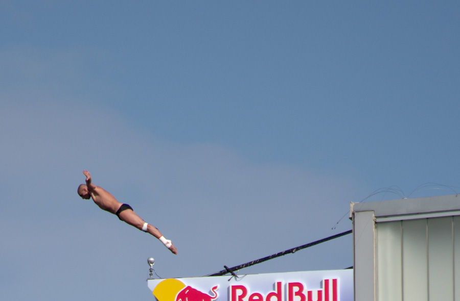 cliff diver outstretched, upward