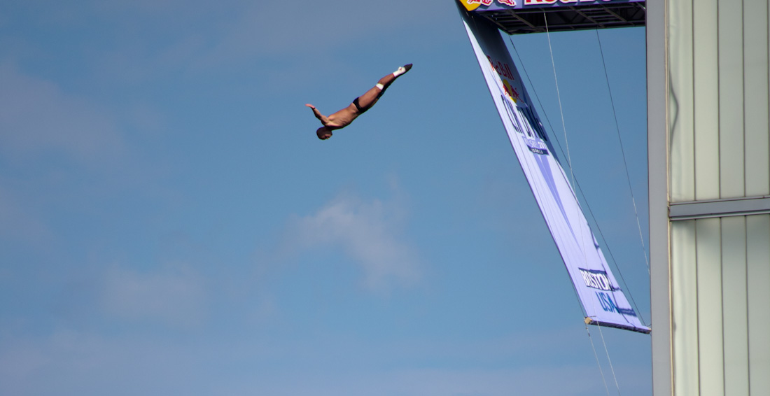 cliff diver outstretched, downard