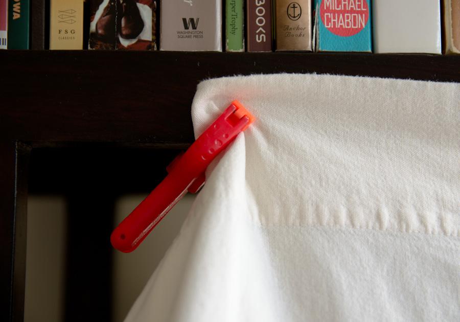 clip holding cloth to bookshelf