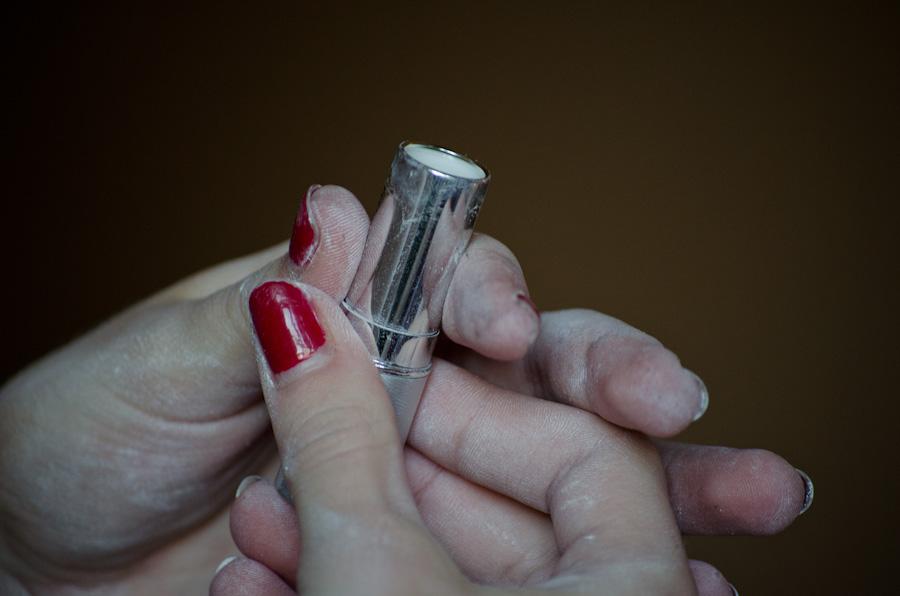 lipstick in hands