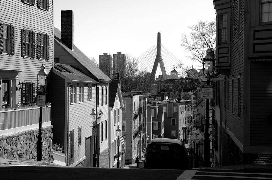 bridge with buildings and hilly street