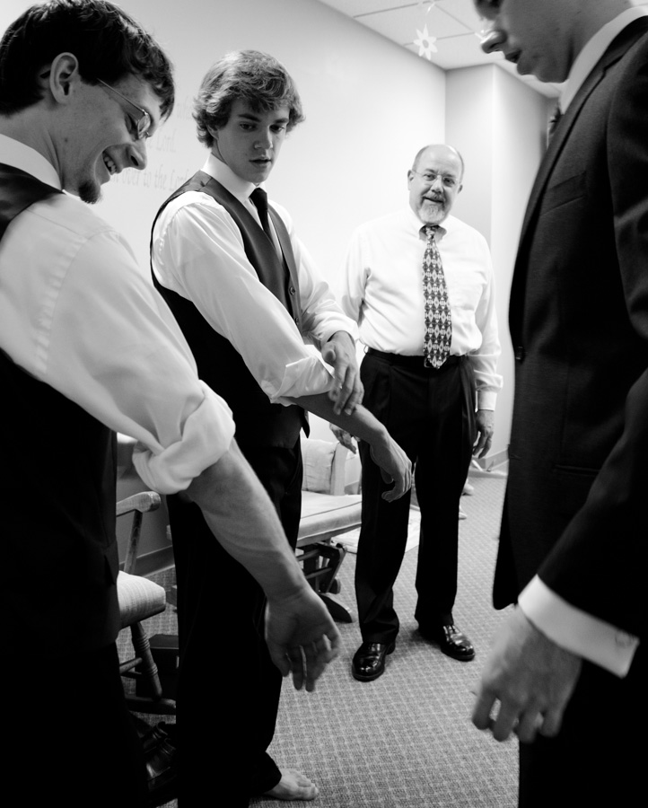 men arranging cuffs