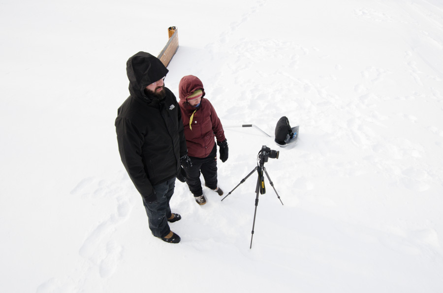 pair with camera in snow