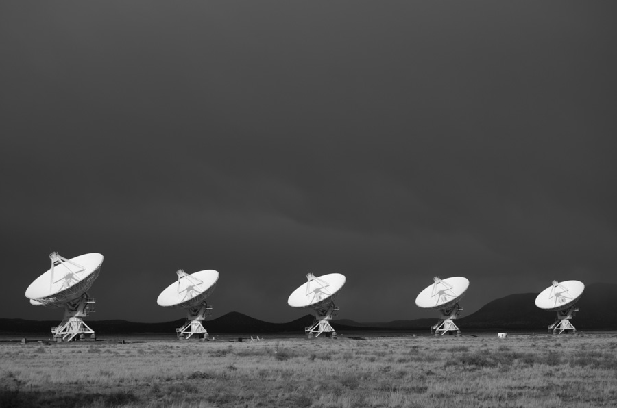 radio telescopes, illuminated with dark background