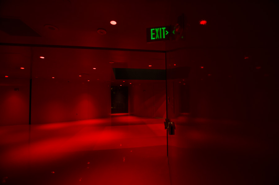 curved red wall and exit sign