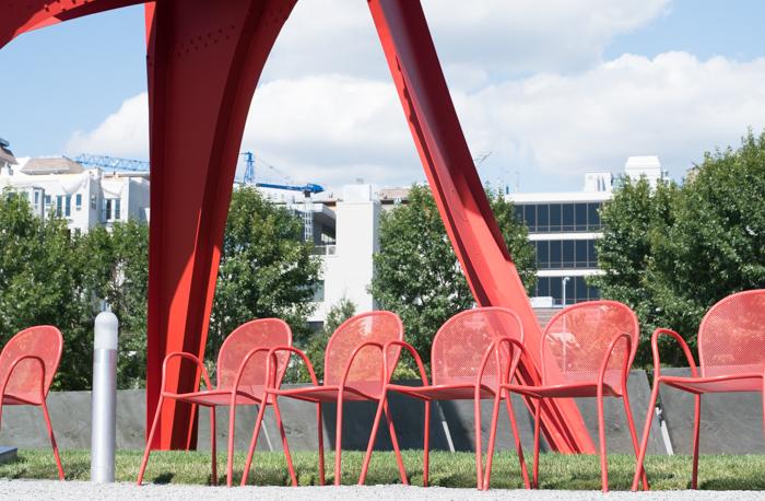 chairs under sculpture